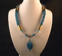 Aqua Viking Knit Bullet Choker Necklace & Earrings. $54.00, via Etsy.