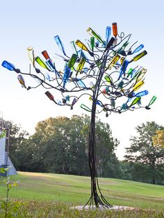 DIY Bottle Tree - C. The Bottle Tree. This is the most beautifully designed tree I've ever s Wine Bottle Trees, Wine Bottle Art, Diy Bottle, Wine Bottle Crafts, Bottle Garden, Glass Garden, Garden Crafts, Garden Projects, Art Projects