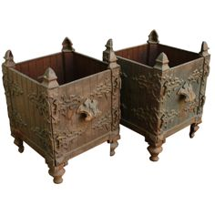 Pair of French Cast-Iron Planters | From a unique collection of antique and modern planters and jardinieres at http://www.1stdibs.com/furniture/building-garden/planters-jardinieres/