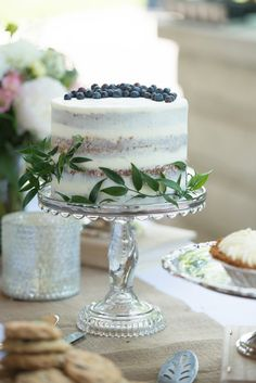 Naked Wedding Cake Topped with Blueberries