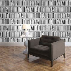Fashion Library Bookcase Wallpaper - Silver - 139502  This fantastic Fashion Library Bookcase Wallpaper by Muriva will make a great feature in any room. The bookcase design features realistic looking books filling the shelves in natural tones of black and grey with glitter highlights and certain elements picked out in silver for added effect. Easy to apply, this high quality vinyl wallpaper will look great when used to decorate a whole room or to create a feature wall. Stunning bookcase…