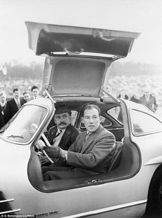 British racecar driver Stirling Moss test drives the Mercedes-Benz 300 SL, later dubbed the Gullwing