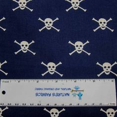 White Skulls on Navy 100% Cotton Woven