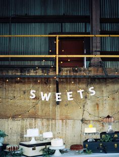 "I like the mix of cakes and the ""SWEETS"" sign. I also have a bunch of old suitcases we could use :)"