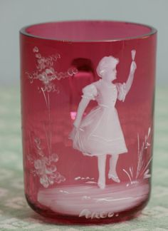 Hand painted Mary Gregory Cranberry Glass tumbler, circa 1900.