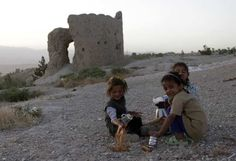 Afghan children sell tea on top of a hill in Kabul July 4, 2012.