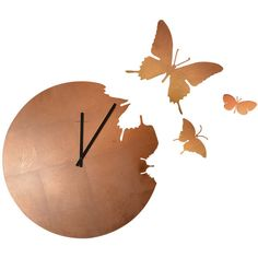 Laser cut steel butterfly clock with tiled copper leaf effect..  We absolutely adore this stylish wall clock designed by Susanne Philippson for the designer It…