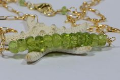 Raw Peridot Bar Necklace Wire Wrapped On 14K Gold Filled  Birthstone Jewelry by Dwaynescabochons on Etsy https://www.etsy.com/listing/190374537/raw-peridot-bar-necklace-wire-wrapped-on