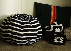 I wanted to try my hand at making a dollar store pouf, and I did it for less than $5! These nylon throw rugs appear at the Dollar Tree frequently, and they usually have some pretty fashionable color choices to choose from. I think this black and white stripe classes up the otherwise cheap 'n cheesy nylon throw rug.