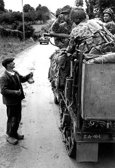 Notre Dame de Cenilly, France - A French farmer offers cider to American soldiers - 28 July 1944