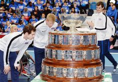 Great Britain's Andy Murray and Kyle Edmund (centre) study the Davis Cup trophy during the photocall at Lee Valley Tennis Centre, London