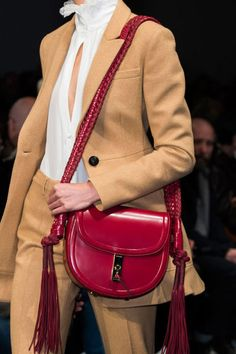 Jaws dropped and virtual wait-lists ensued when Joseph Altuzarra debuted what is sure to be next season's It bag—a lipstick red braided andfringed messenger style with serious status to boot.