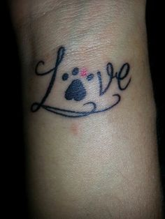 Probably my favorite tattoo...I designed this to have one pink finger because my little shih Tzu has a paw that is all black with one pink finger...It's adorable lol
