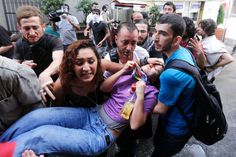 An injured demonstrator is carried by fellow protesters during a demonstration against the planned construction of a new shopping mall at Taksim Square in Istanbul, on May 31, 2013.