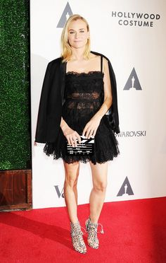 Rockstar princess or Diane Kruger? Either way we love this see-through lace fit and flare dress