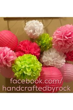 Watermelon theme party poms. One in a melon. Light pink, dark pink, green, white.
