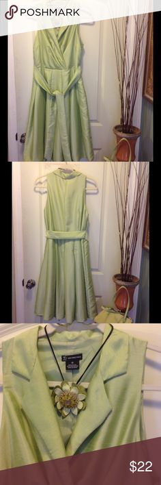 """Satin celery green modern men style dress This dress is a great way to mix your retro vintage accessories like broaches and bags  feels and looks like satin  wrap style top with full pleated A line skirt 58%nylon and 42% polyester  by new directions  hidden side zipper  bust 19""""x2 flat. Waist 17""""x2 with wide matching attached belt. Length 42"""". Fully lined. Perfect for church or office new directions Dresses Midi"""