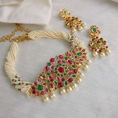 Looking for ruby emerald necklace designs? Here are our picks of 20 designs and where you can shop them online! Indian Jewelry Earrings, Ruby Jewelry, Bridal Jewelry, Beaded Jewelry, Gold Jewelry, India Jewelry, Jewelry Shop, Jewlery, Pearl Necklace Designs