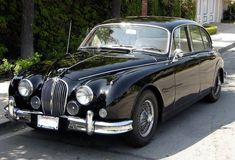 This 1963 Jaguar MkII runs a later 4.2 XK motor and 4-speed pulled from an E-type. The car looks very clean and straight in photos, and the ...