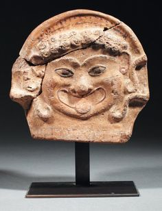 Greek polychromed terracotta antefix, 6th century B.C. From Sicily, represent Gorgon, 17.5 cm high. Private collection