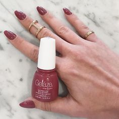 My new favorite claw color! Fifth Avenue Geláze by China Glaze. The perfect deep mauve  I'm getting better at doing my own acrylics, too! Still not perfect.. but I'm proud! What's your favorite nail color right now? Any I should try out? I also bought Ruby Pumps (sparkly red- shout out to my go to color in '08!) which I'll wear for Christmas ✨