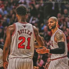 jimmy butler and carlos boozer high fiving