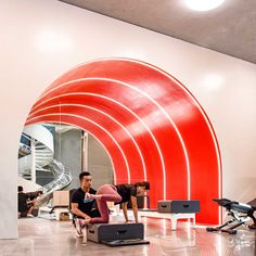 A Two-Story Gym in Beijing That Comes Complete with a Slide - Design Milk