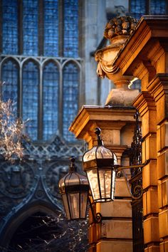 """Clare College gate Cambridge University Cambridge, UK - """"Warm afternoon light reflects back from the building opposite this ornate gateway at the front of Clare College. In the background the huge sides of King's College Chapel sits in cold shadow."""""""