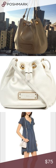 Marc Jacobs Too Hot Leather Mini Bucket Bag Marc By Marc Jacobs Too Hot Leather Mini Bucket Bag in white -- A petite Marc by Marc Jacobs bucket bag in pebbled leather. A logo plaque accents the front, and polished grommets lend shine to the drawstring top line. Lined interior. Adjustable shoulder strap. good condition overall but there are some makeup marks on the lining inside the bag -- 7/10 condition overall reflected in the price -- please let me know if you have any questions! Marc by…