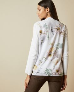 "Bring a feminine finish to any look with the KATIIEY cardigan. Featuring the blooming florals of the Woodland print on the back, it's ideal for layering when its slightly cooler outside. - Ted Baker womenswear collection - Woodland print at back - No closure - Long sleeved - Our model is 5'9"" / 1.75m and wears a Ted size 1"