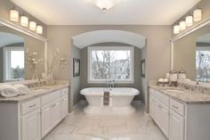 Master bathroom with separate his and her sinks, beautiful flooring and countertops, and freestanding tub | 2014 Fall Parade of Homes Model  - Creek Hill Custom Homes MN