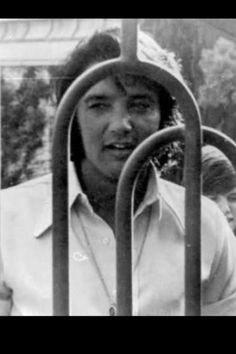 Elvis Presley at the gates of 1174 Hillcrest Drive, Beverly Hills.