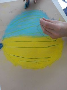 Turning this dull world upside down yellow and blue onion chalk drawing Gregor lifestart alloa