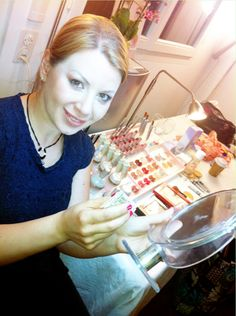 Christine applying Dianne Brill Beauty home party goodies and loving itx