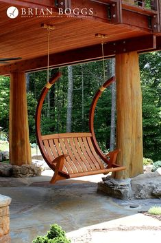 Relax in unrivaled style and comfort with our deluxe porch swing. Inspired by the flowing curves of oriental timber frame architecture, this design swings on silent bushings when attached to its optional cantilevered stand. Weatherproofing is accomplished through slow set lamination, precision joinery and premium wood selection. Finish Penetrating oil finish for a natural look. Materials Sustainably sourced Honduran mahogany Stainless steel hardware Recycled rubber footpads Dimensions T...