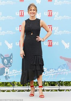 Jennifer, get back to your normal stylish self - it's an OK dress, but not really you - and what's happened to your make up?