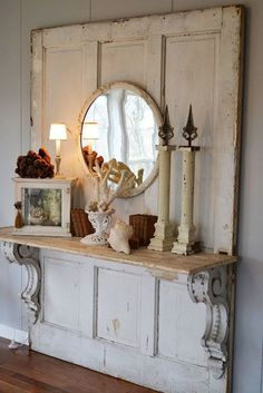 Old doors, corbels & shelf, & mirror. Gorgeous! Old door repurposed into an entry table with corbels, shelf, & mirror. Hooks or vintage doorknobs could be added to make it a hall tree. Salvaged items turned into beautiful home decor!