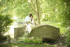 Bride and groom on stone bridge with intimate pond in the background...#thekellygallery #kcweddings #kcvenue #wedding #photography #weddingday #photooftheday