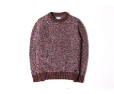 A heavyweight sweater constructed from a recycled wool blend, featuring contrast...