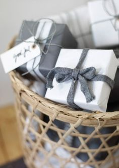 Gray and white wrapping - simple but effective and what a good idea to store in a open-weave basket