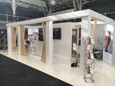 Clean, open exhibition stand, use of natural timber for organic feel. Designed and built by MxL Ltd.