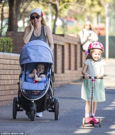 Channel 7 weather presenter Sarah Cumming pushed her pram while chatting happily on the phone during family stroll on Friday. Micro Scooter, Celebs, Celebrities, Scooters, Baby Strollers, Channel, Take That, Daughter, Weather
