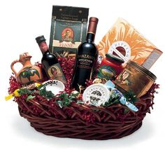 """""""Fiesta D'Italia Basket"""" Awaken the spirit and warmth of the Italian countryside with this selection of Tuscan treats. Italian wine, balsamic vinegar, pasta, pasta sauce, olive oil, crackers, Italian biscotti, chocolates and a hand-painted dish! Penne, Pasta, Indian Beadwork, Wine Baskets, Italian Wine, Balsamic Vinegar, Treats, Gifts, Wine Coolers"""