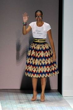 "Designer Stella Jean acknowledges the audience as she wears a shirt with writing in Italian reading ""Thank you Mr. Armani"", at the end of he..."