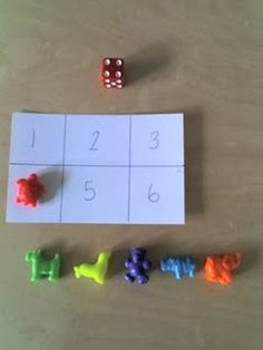 "Really simple number recognition bingo game - divide a card into 6 squares & number them. The child rolls the die. When they roll a 1, they cover up the number 1 on the card. They roll until they have covered all the numbers. Use whatever you like as markers ("",) ("",)"