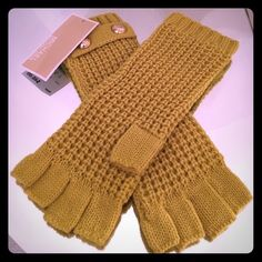 NWT Michael Kors lemon fingerless studded gloves Extremely beautiful and super classy fingerless/text gloves by MICHAEL Michael Kors! These beautiful knit gloves come up mid arm and have stunning gold MK emblems at the top as seen in pictures! This color is hard-to-find it is the color lemon style number 536175. These are brand-new with retail tag and ready to ship! NOTE: Bundle any of my Michael Kors winter accessories for 20% off of the total! Thank you for looking- SHIPS FAST! MICHAEL…