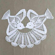 Birds of a feather are stitched together in this gorgeous thread crochet creation.  Birds are crocheted seperately and then stitched together with a lace skirt.  The birds are worked with crochet cotton thread size 10 and a steel crochet hook.