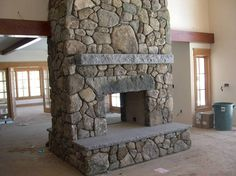 pass through fireplace | Pass-through fieldstone fireplace with antique granite lintel and ...