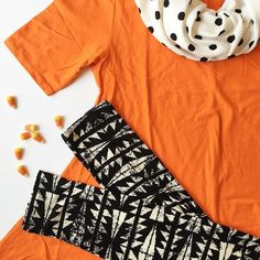 super cute LuLaRoe Halloween outfit. Black & white Leggings, orange Classic Tee, polka dot Cassie skirt as a scarf