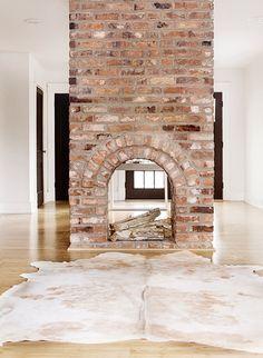 "I have dreamed of a 2-sided fireplace!  From ""A Minimalist Nashville Abode Home to a Textile Designer"" via Design*Sponge"